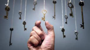 Choosing the key to success from hanging keys concept for aspira